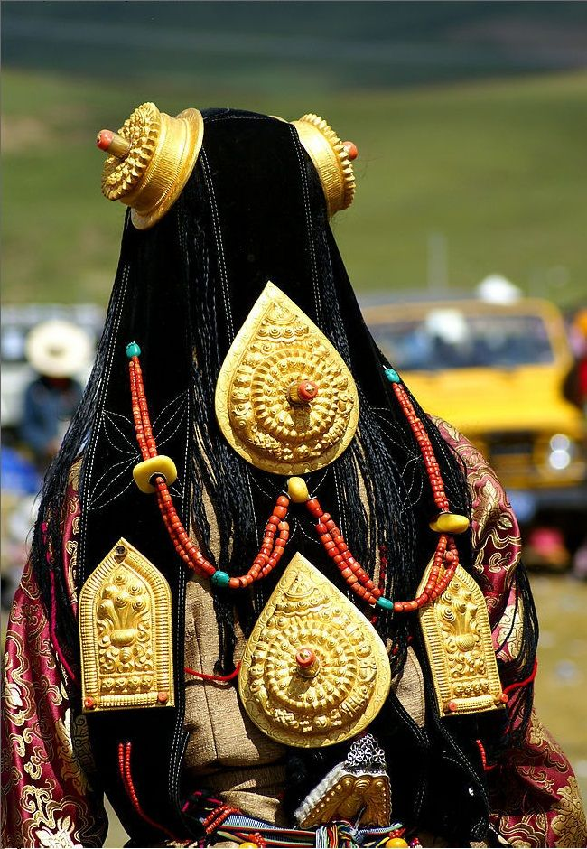 Tibetan Jewellery.  Ornate, massive, pure gold ornaments worn by bejewelled girl at Lithang Horse Festival.