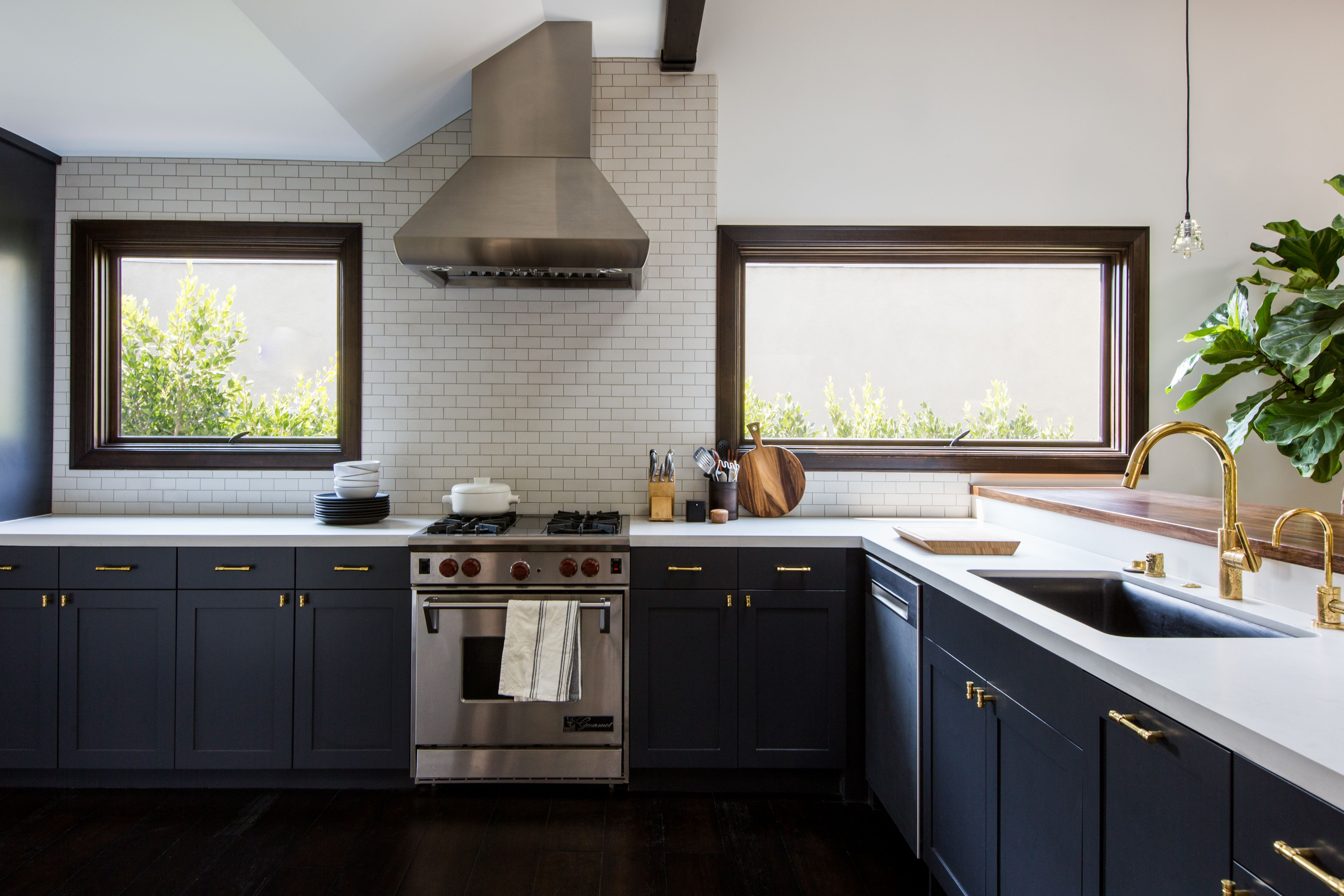 The Black And White Kitchen In A 1920s La Bungalow Remodel By Brian Paquette Remodelista Kitchen Design Blue Kitchen Cabinets Navy Blue Kitchen Cabinets