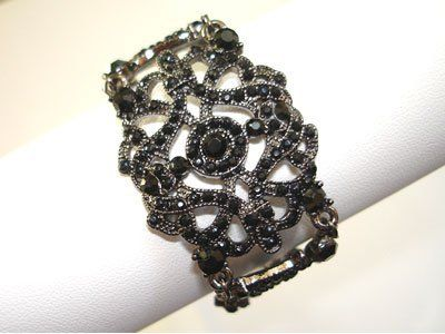 Black Austrian Crystal Rhinestone Victorian Style Bracelet with Black Rhodium Plated WSQUARED2.com. $12.95. Material: Austrian Crystal Rhinestone. Center measures 1.50 inch in diameter. Metal: Silver-Tone with Black Rhodium Plated. Size: 7 inch with 1 inch extension. Weighs approximately 16.5 grams. Save 57%!