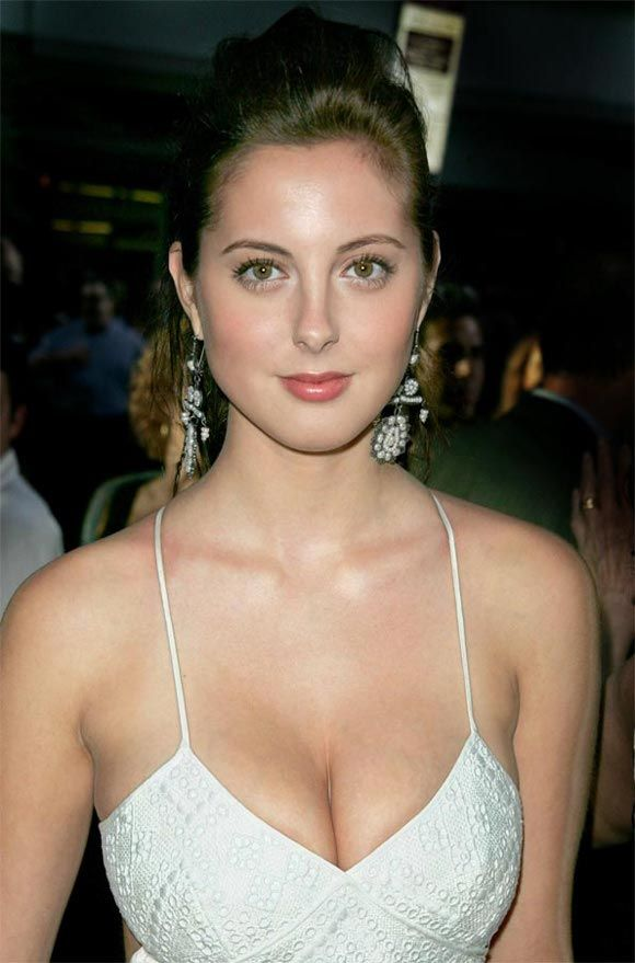 Which busty beauty has best cleavage