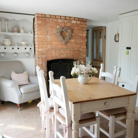 country cottage dining room. dining room with fireplace