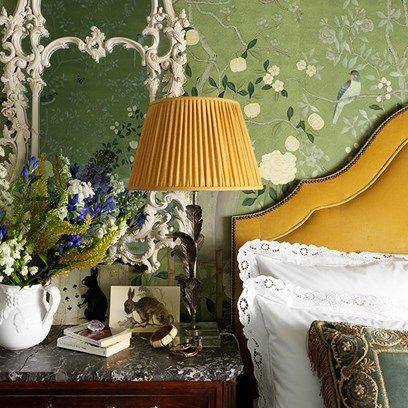 Bedroom with green floral de gournay wallpaper