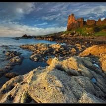 "Touched by the ""Golden Hour"", the ruins of Dunure Castle, located on the west coast of Scotland, in South Ayrshirestill, looks out to the sea. Although it has been a ruin for at least three hundred years, Dunure Castle was once the main fortress of the powerful Kennedy family, the Earls of Cassilis. The castle's origins probably date back to at least the 1200s when a stone keep was built on an easily defensible rocky outcrop overlooking the Firth of Clyde."