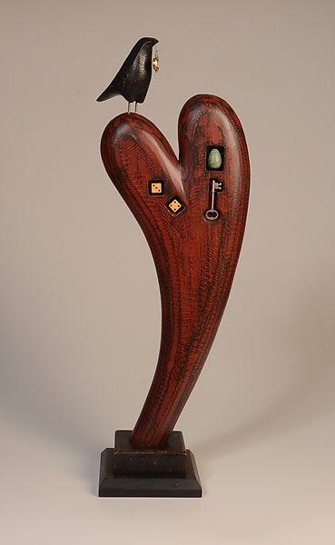Raven on curved heart mark orr wood sculpture artful