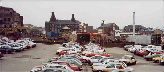 Car park on Commerce Street, Longton. The bottle kilns of the Chetham Works can be seen in the background.