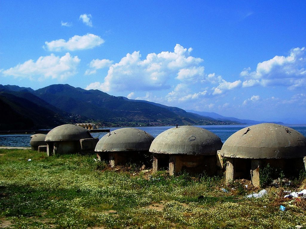 Former dictator Hoxha of Albania gave order to build 700.000 iglo bunkers to serve as shelter for the people during the cold war. They were so indestructible that the majority still stands and serves for all kinds of funny purposes.