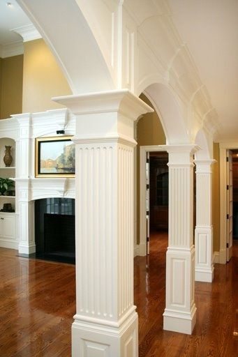 Columns And Archways Between Kitchen And Living Room