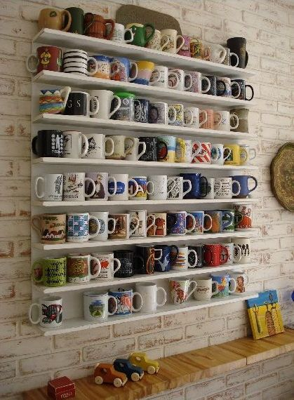 Coffee cup wall...and this is why i have a board for cups. I dont want any copy cups when i have my own place.
