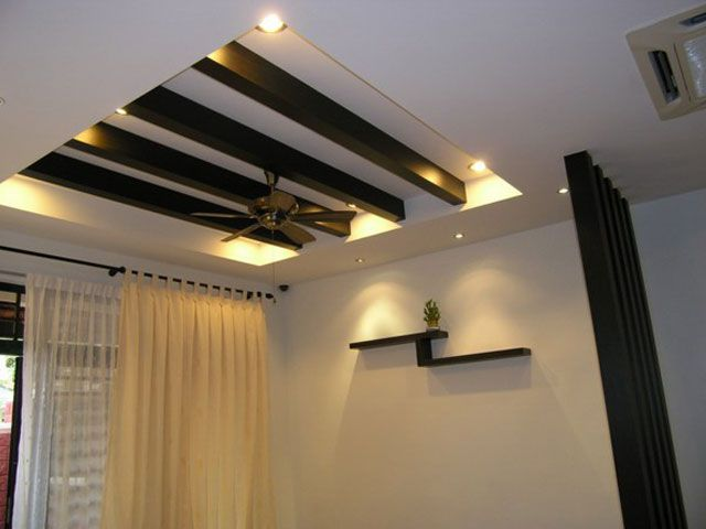Modern Elegant Plaster Ceiling With Wooden Interior And Grey Fan