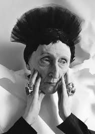 The English eccentric poet, Edith Sitwell wearing her piles of rings in the 1930s.