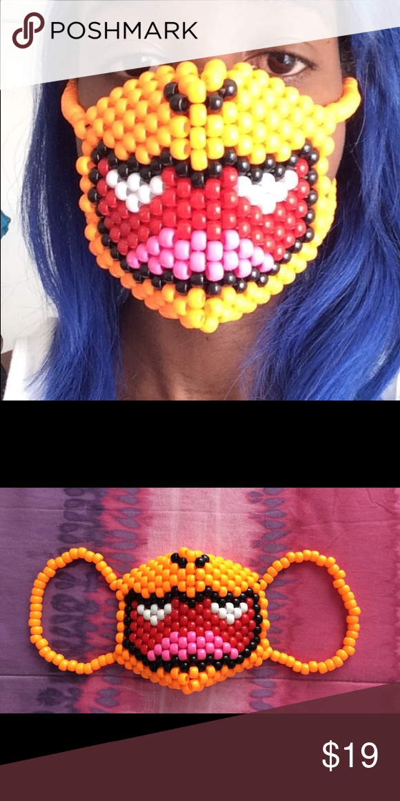 Charmander Kandi Mask A Charmander Kandi mask. Great for raves, festivals, cosplaying or Halloween! Masks are unisex so it can be worn by a woman or man. These are made to order so please allow up to 3 to 5 days to complete. $15 (etsy), $19 (poshmark). If you have any questions feel free to ask :). KandiKraverCreations Accessories