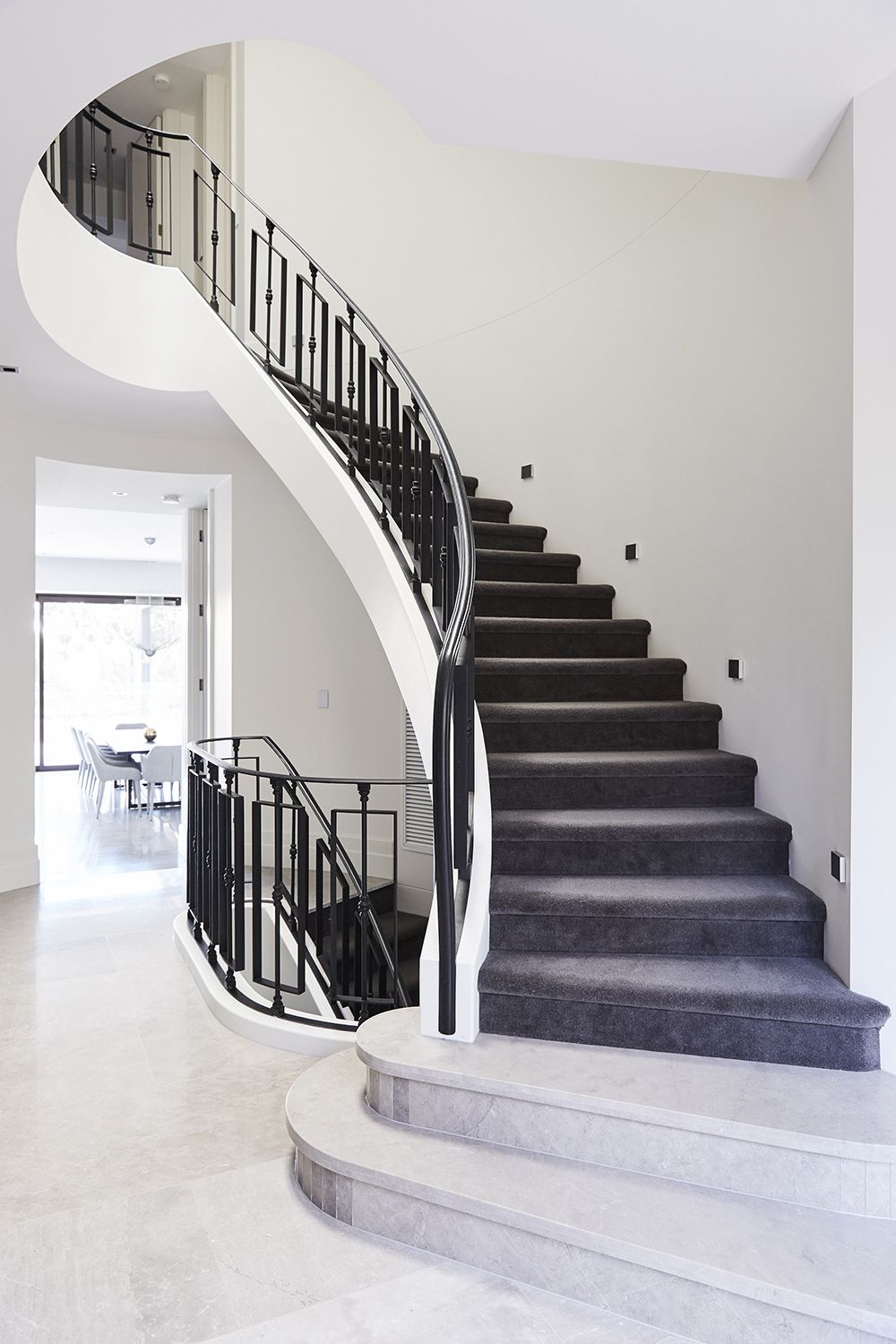 Best Stairs Curved Staircase Carpeted Stair Wrought Iron 400 x 300