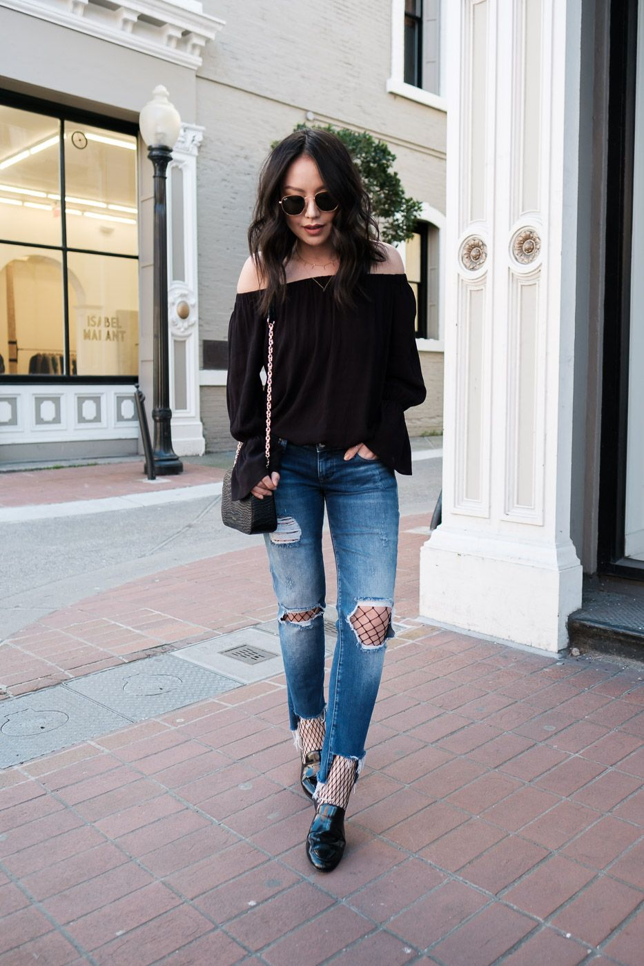 c3fd23a79d How to wear fishnet tights: Pair with a solid off-the-shoulder top and  minimal jewelry.