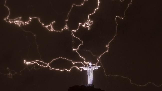 Show time ... A lightning flashes over the statue of Christ the Redeemer on top of the Corcovado hill in Rio de Janeiro, Braz...
