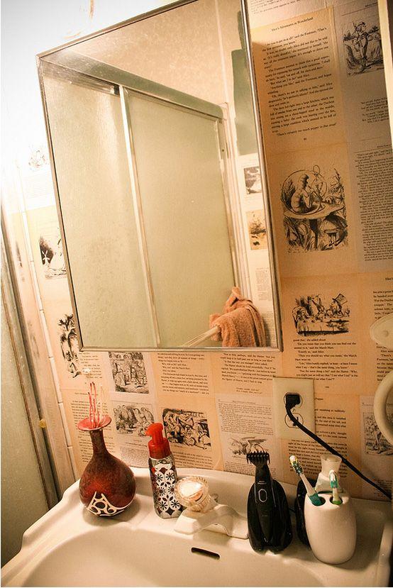 "Bathroom wallpapered in ""Alice In Wonderland"" book pages!   #aliceinwonderland #bookpagewallpaper"