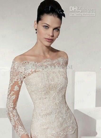 The neckline and lace sleeves on this dress are so unique and classy