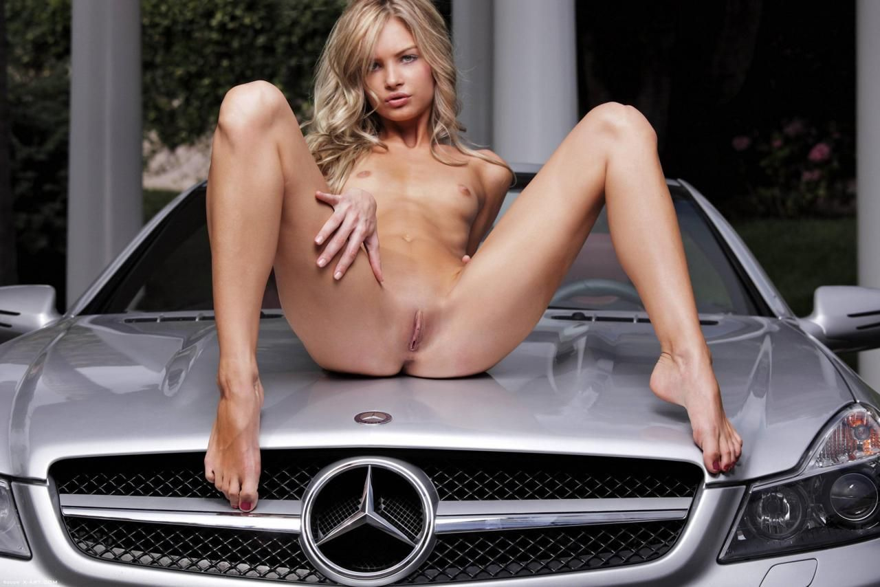 Short haired russian girl posing naked at public near car     Caribe Campo Condo Rentals   Sales