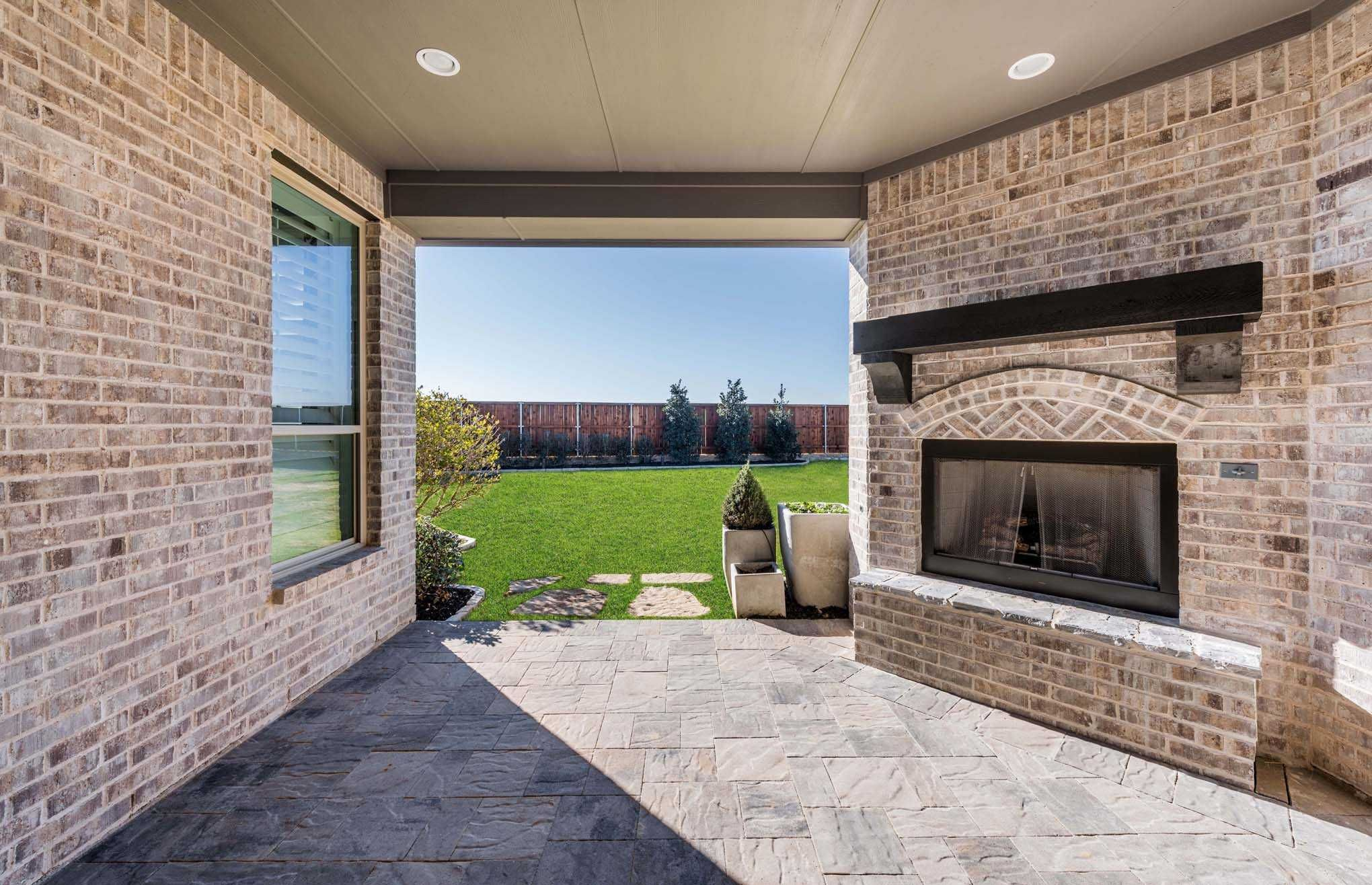 Back patio in highland homes 262 plan at 1801 kyle court