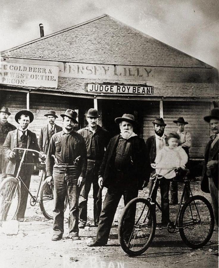 Judge Roy Bean with assorted wastrels and miscreants in front of the Jersey Lily, circa 1900.