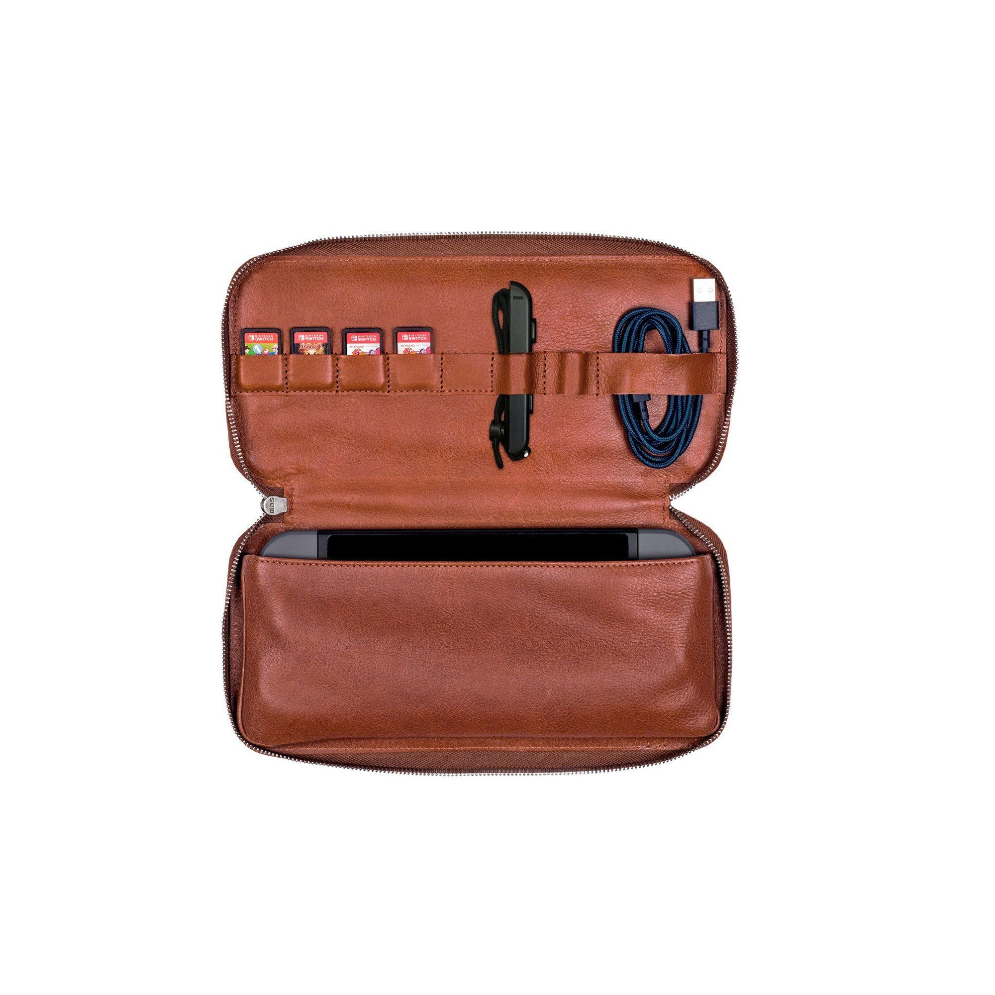 e1159621e7e14c Keep your Nintendo Switch safe and secure in our 100% bovine vegetable  tanned leather travel case. The high end case is designed to hold the  Switch