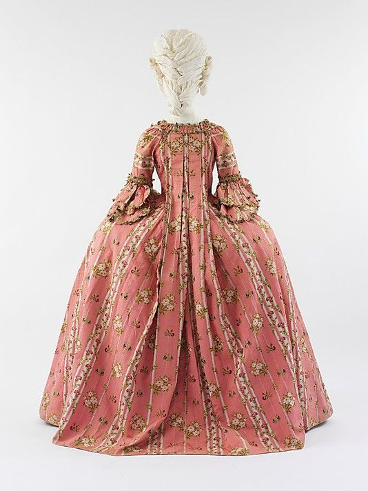 Bakc view, Robe à la francaise, France, c. 1775. Brocaded pink and cream striped silk with flower sprays.