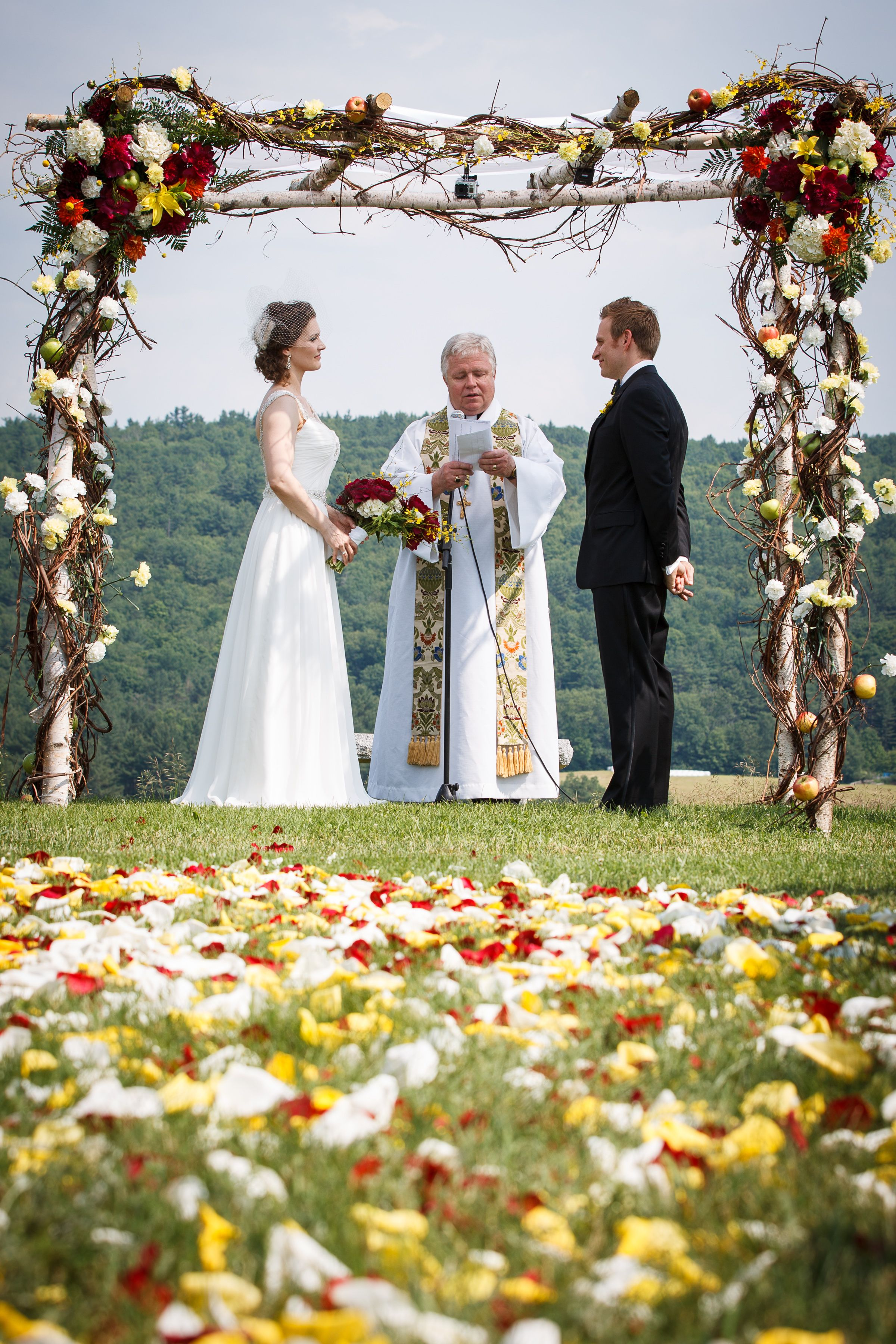 These rose pedals add a certain charm to the wedding. This is also a great way to incorporate your wedding colors into the ceremony! Photo Credit: Kendal J. Bush