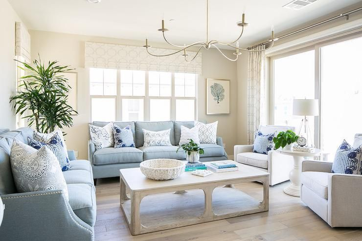 Lovely Blue And White Living Room Features A Cfc Gimso Coffee Table Seating Two Powd Blue Sofas Living Room Blue Living Room Decor Light Blue Couch Living Room