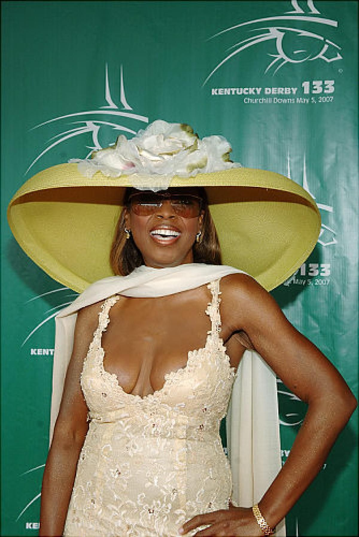 We think that's Star Jones under there, but with a hat that large and her dramatic weight loss, it's really hard to tell.