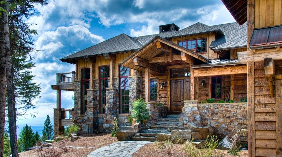 Western rustic timber stone montana mountain ski home traditional rustic homes pinterest Rustic home architecture