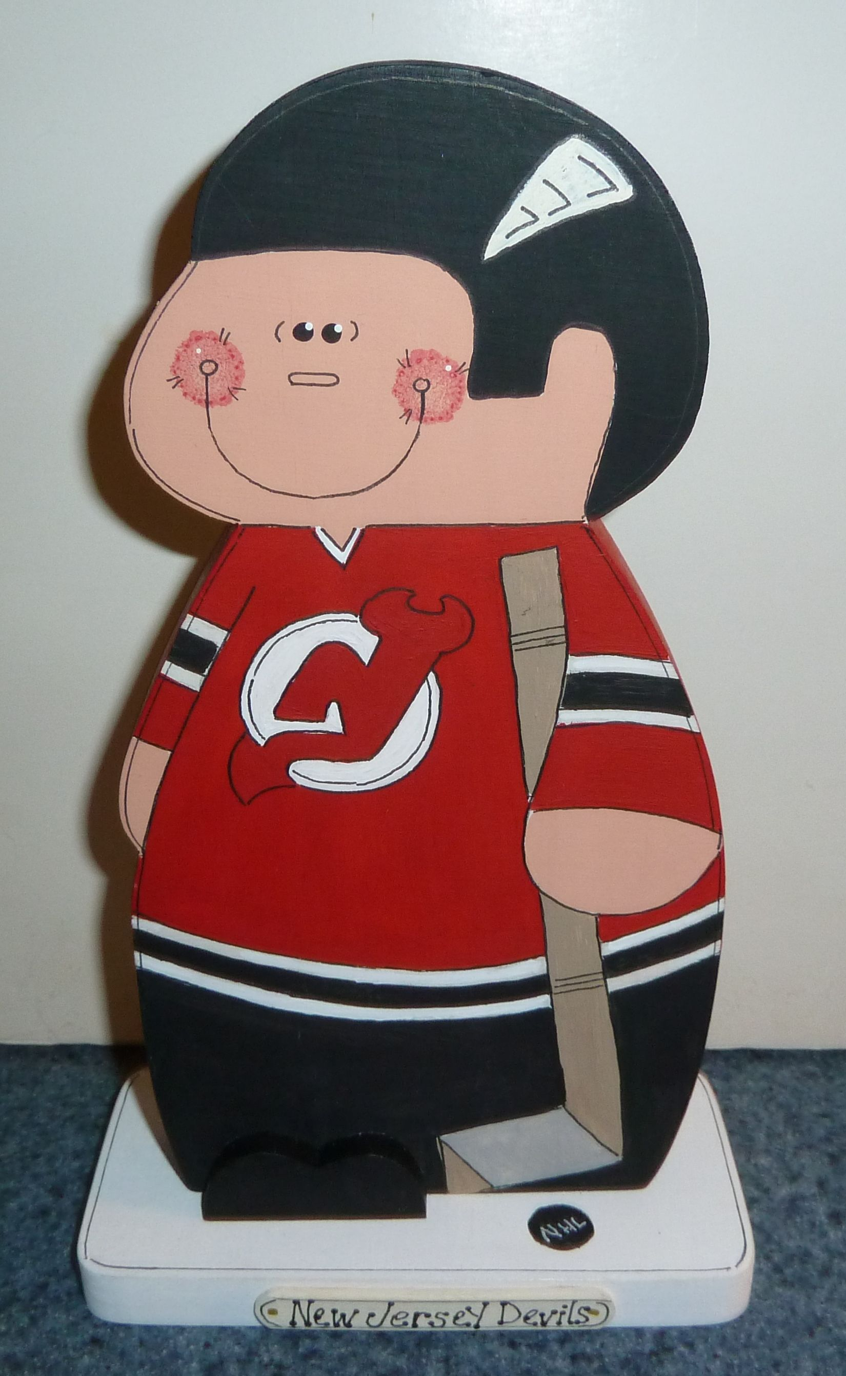 New York Devils hockey player. He is handmade, cut from wood, then handpainted with acrylic paints...great unique gift...