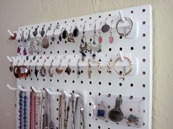 The most versatile wall-hanging jewelry organizer ever! Contemporary  design. Movable hooks and