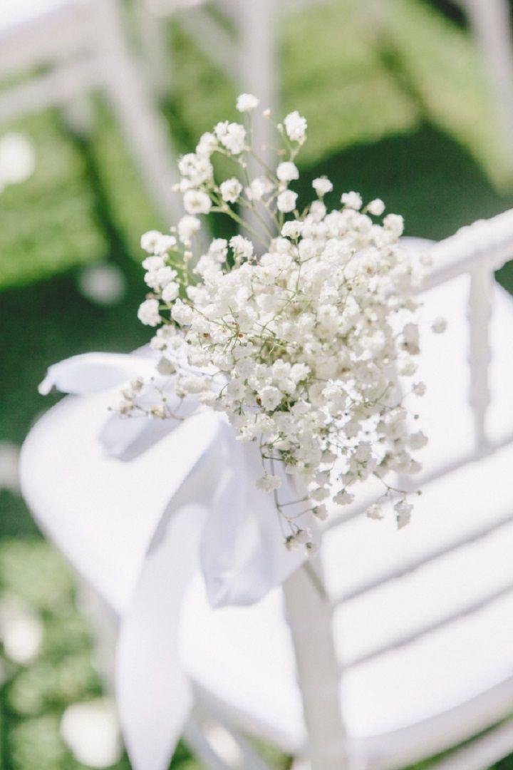 Baby's breath decoration wedding chairs for a Breathtaking Fairytale Venice Wedding + Steven Khalil wedding dress | itakeyou.co.uk #wedding #venicewedding #weddingceremony #babysbreath #weddingchairs  #white #goldwedding #fairytalewedding