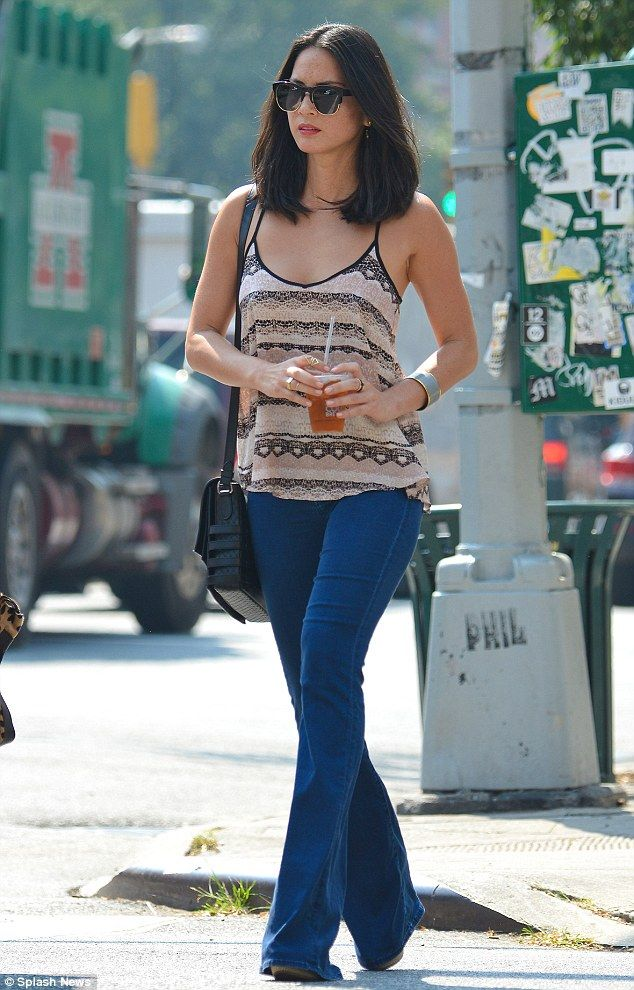 Out and about: Olivia Munn appeared to be wearing the same pair of flared jeans when she ventured out in New York City earlier that day, sho...
