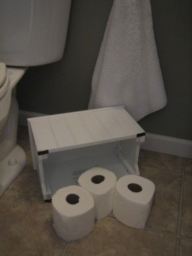 Step Stool Hides Toilet Paper Surplus In Powder Room Where There