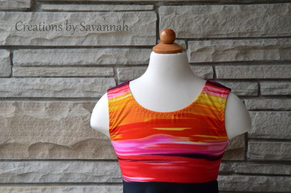 Such cute colors!! I am in love with the look of this suit! Stay covered and comfy in this awesome, modest swimsuit, this Summer! I cut this out as a