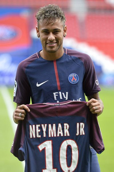 83f58492a61e3 Neymar poses with his new jersey after a press conference with Paris  Saint-Germain President Nasser Al-Khelaifi on August 4