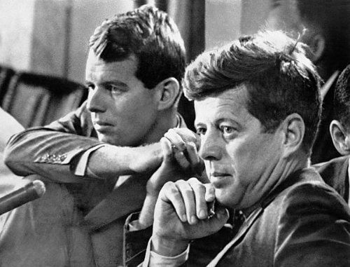 Photo of Robert Kennedy with his brother, John F. Kennedy, at a committee hearing. Robert F. Kennedy has confirmed reports that he will resign soon as chief counsel for the Senate Rackets Investigating Committee.  PHOTOGRAPHER / CREDIT: World Telegram & Sun