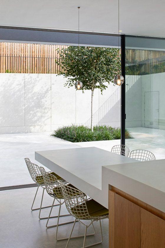 Photo of La casa del jardín de De Matos Ryan   Casas familiares