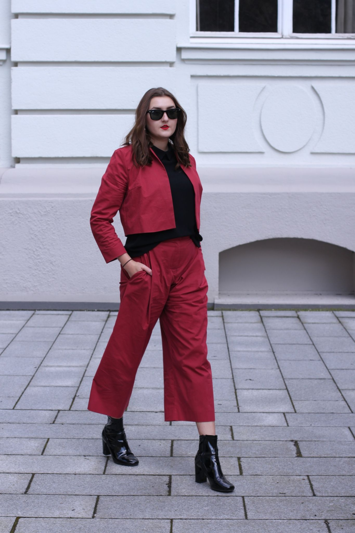 red suit with a culotte & patent leather boots | lauracoeur.com