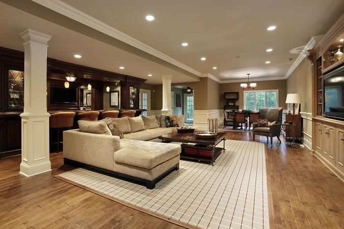 Decoration, The Exciting Design Of Luxury Basement With Brown Laminating Flooring And Brown Sofa Also With Black Rectangle Table On White Carpet Also With White Cabinet And White Roof With Best Lighting Ideas ~ The Beautiful Design Of Luxury Basements With New Style And Amazing Decoration