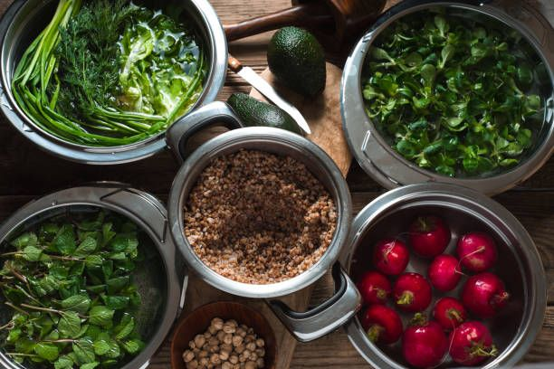 ingredients for healthy salad with buckwheat and greens top view