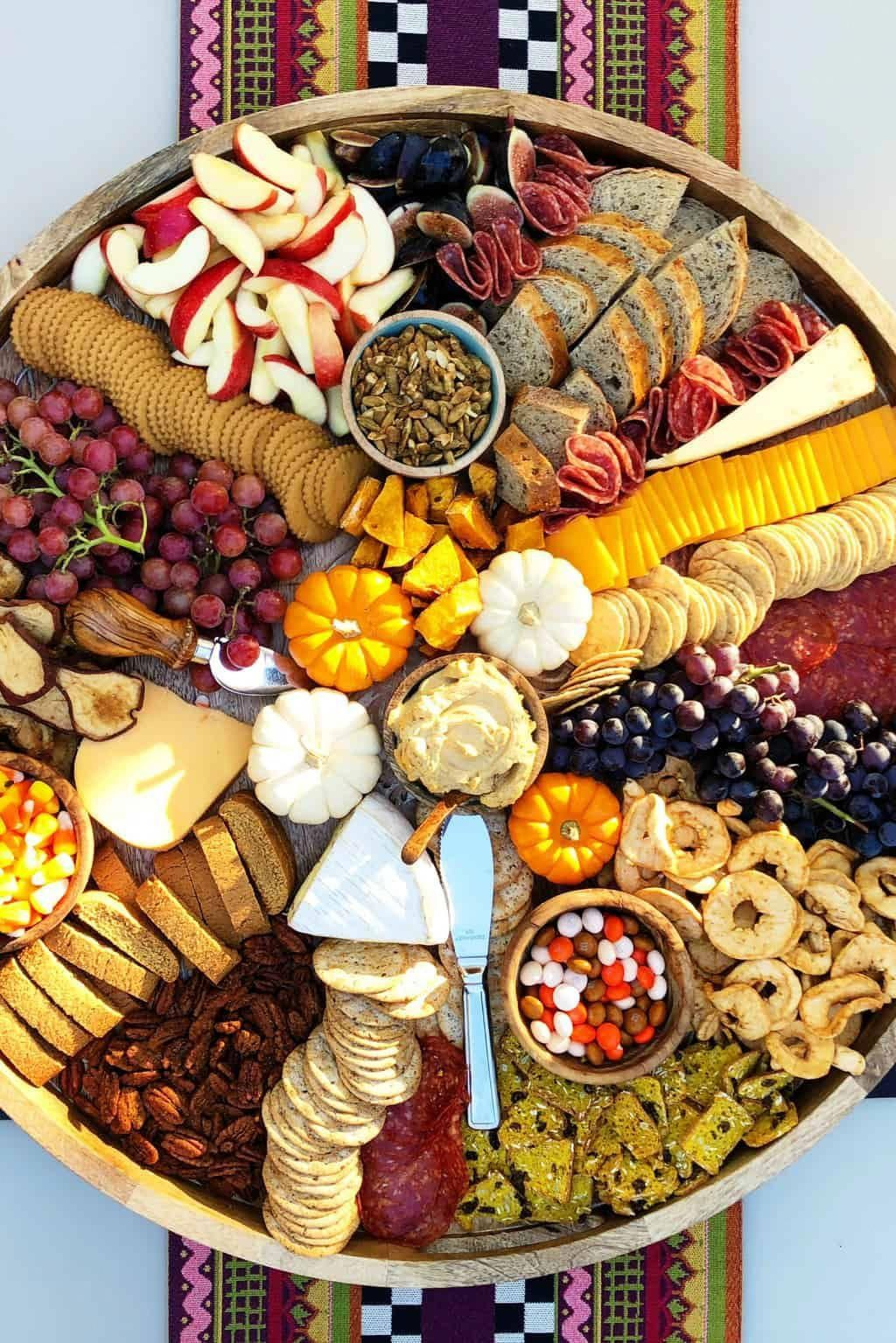 Fall Epic Charcuterie Board for casual entertaining, filled with pumpkin treats, best cheese and cured meats, with fruits, nuts, and crackers! #epic #epiccharcuterie #fallcharcuterie #charcuterieboard #partyfood #fallfood #appetizer #halloween #fallappetizers