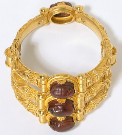 Bracelet, by Alfredo Castellani (1853 - 1930)Bracelet By Alfredo Castellani (1853 - 1930) Rome, Italy 1925  Gold bracelet with three parts at the front, each decorated with applied wirework and granulation and mounted with four cornelian scarabs, one on the back.