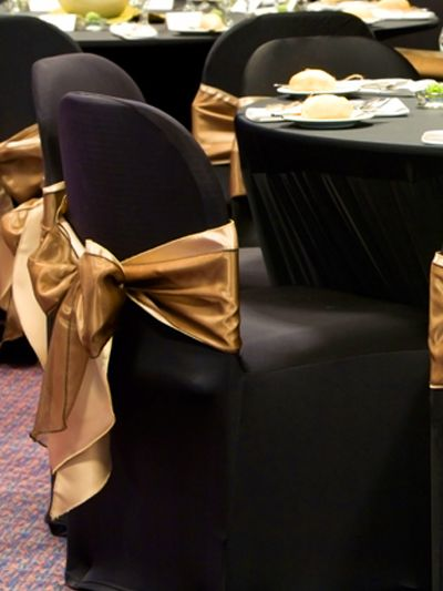 Black spandex chair cover with simple gold sash  Chair