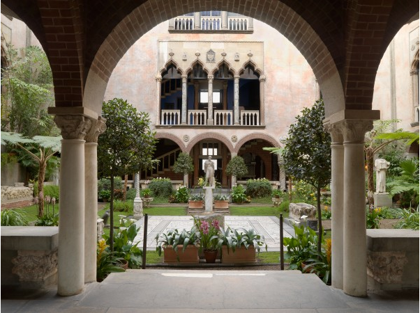 Breath taking spanish courtyard with tropical plants and flowers at Issabella Gardner Museum.