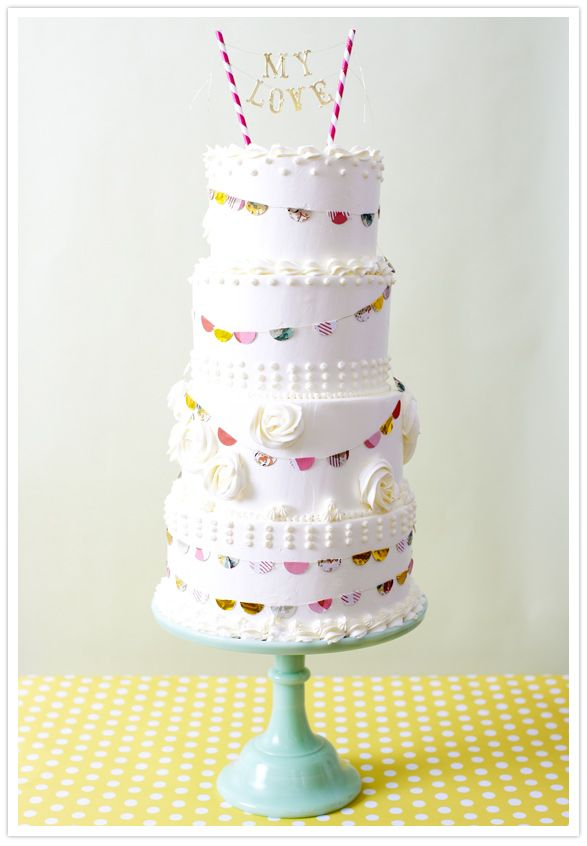 beautiful layer cake with bunting & cool cake topper