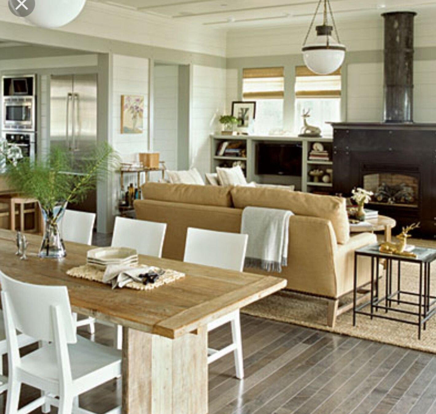 Love the open floor plan... And the grey wood floors.