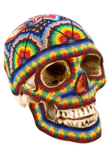 OUR EXQUISITE CORPSE Skull  Wax skull on a resin base covered with multicoloured beads made by Huichol artists from western Mexico who specialise in relief artwork. Limited collection. Made entirely by hand.