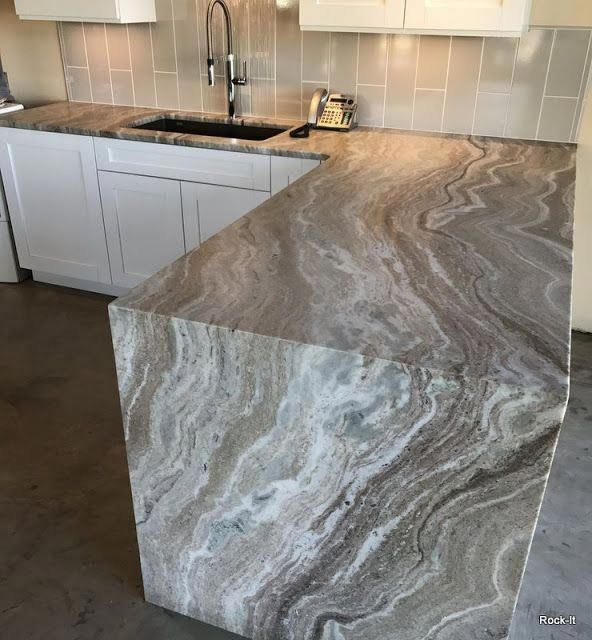 Rock-It Surfaces Granite Countertop News at www.rockyourhome.com: Fantasy Brown Leather with Waterfall #kitchencountertopsquartziteideas #waterfallcountertop