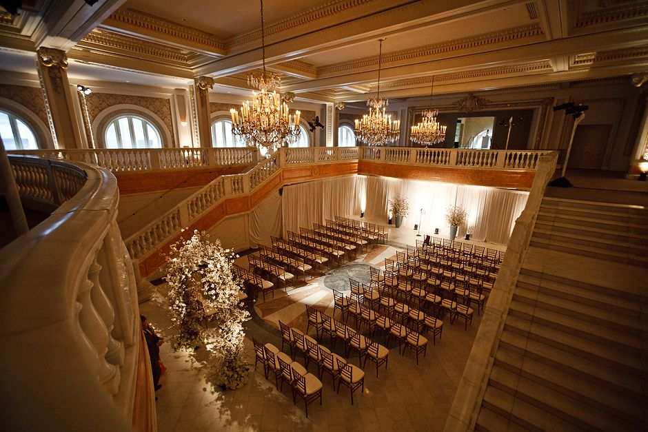 A View Of The Ceremony Set Up With Chairs And Fl Arch From Balcony